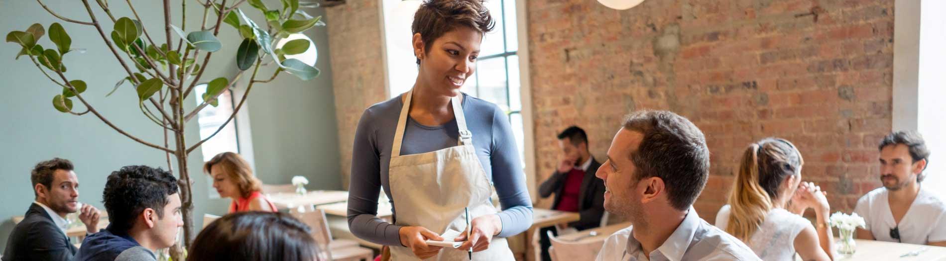 waitress taking man's order Restaurant Insurance