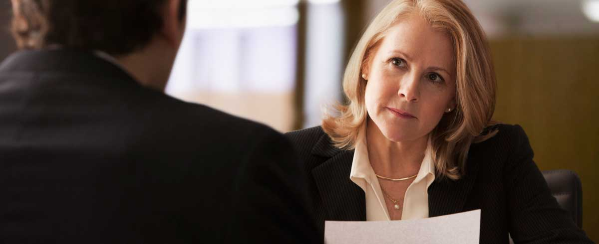 business woman looking at man during interview
